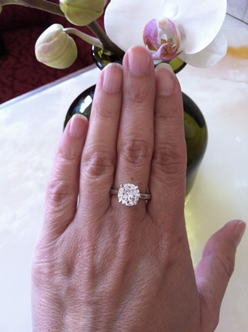 Kim Solitaire engagement ring on hand