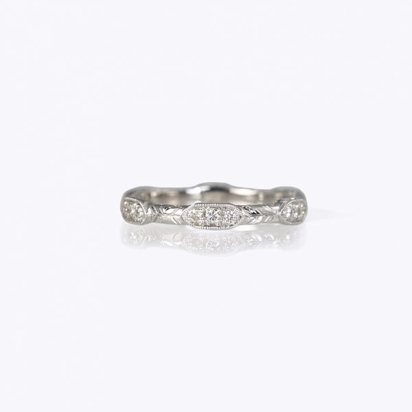 Sophia wedding ring custom made by Cynthia Britt is a delicate ring made to fit right next to her engagement ring