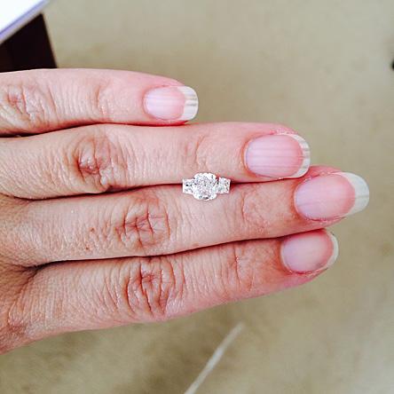 Cushion cut diamond with trapezoid diamonds