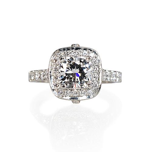 Platinum and cushion cut diamond engagement ring